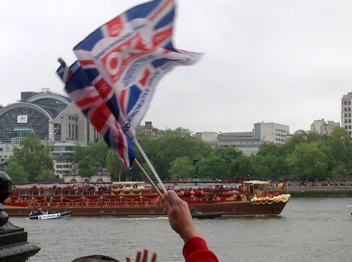 The Royal Family's ride; the Queen is in white at the center of the boat.  Cheers went up and hands/flags were waving as it passed
