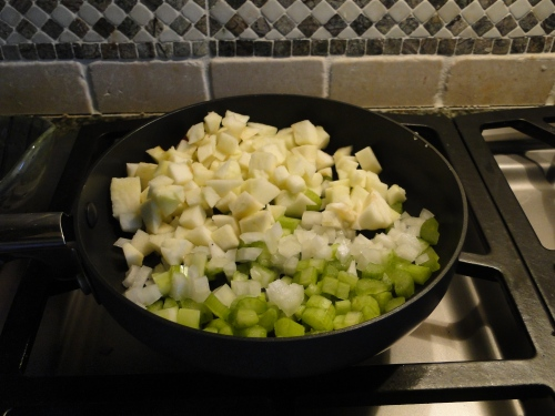 Melt the butter and cook the onion, celery, and apple
