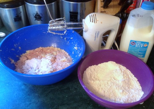 Mix the milk and dry ingredients into the batter in increments